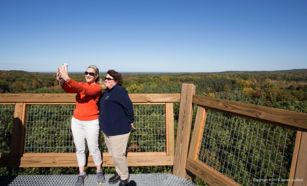 Photo: Two women take photo of themselves at the top of the tower. Photo by James Guilford.