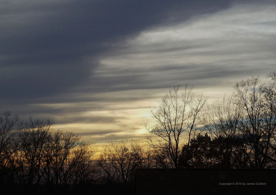 Photo: Streaked clouds in approaching sunset. Photo by James Guilford.