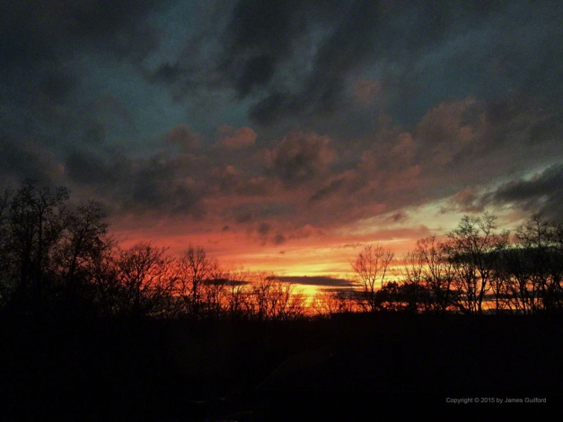 Photo: November sunset illuminates horizon and clouds overhead. Photo by James Guilford.