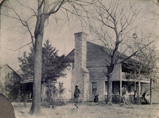 Photo: Antique photo of family and their home in War Eagle, Arkansas.