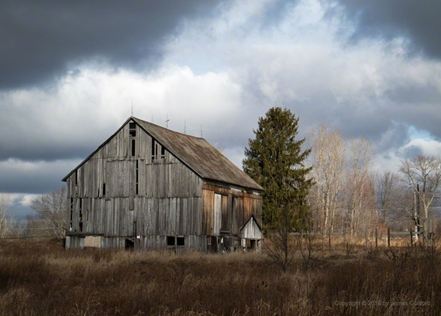 Photo: Old weathered barn and dramatic sky. Photo by James Guilford.