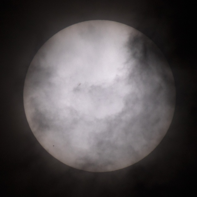 Photo: Clouds interfere with view of Mercury's transit. Photo by James Guilford.