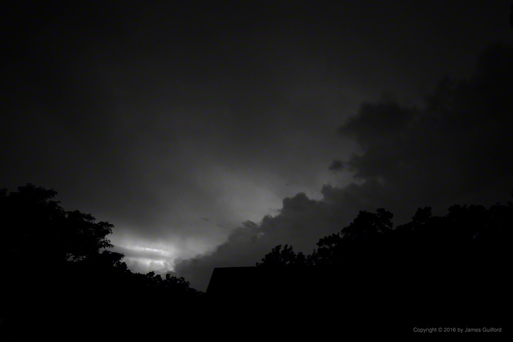Photo: Lighting up the Distant Clouds. Photo by James Guilford.