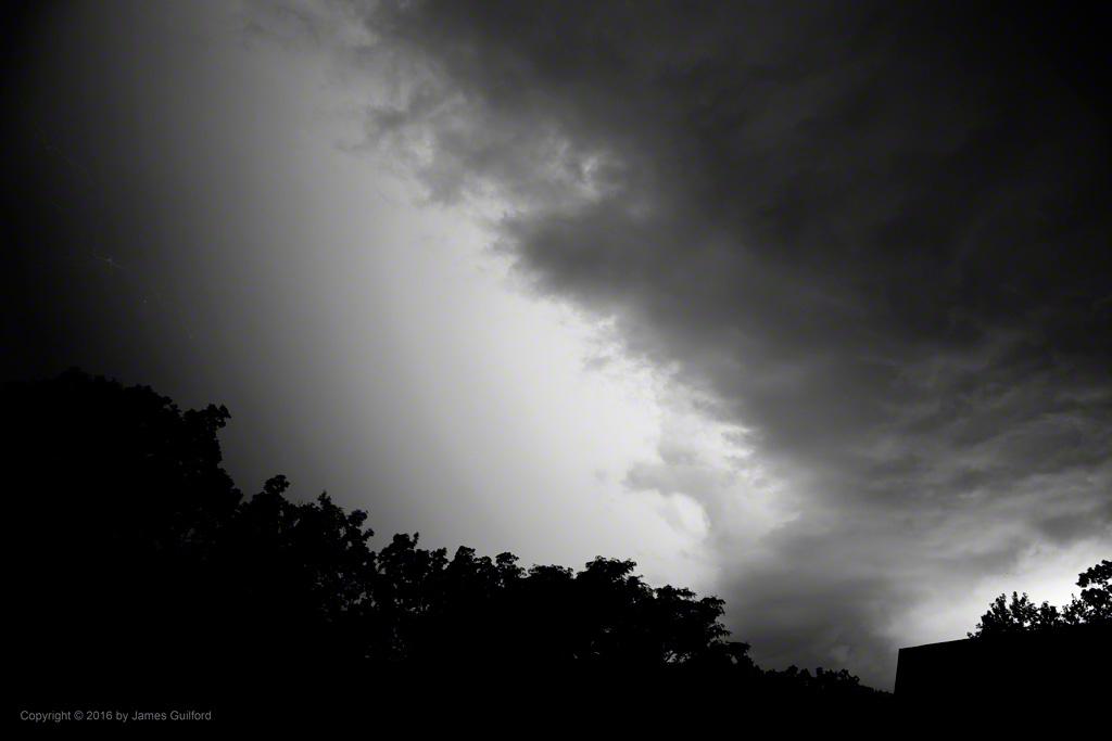 Photo: Intense hidden lightning illuminates the sky. Photo by James Guilford.