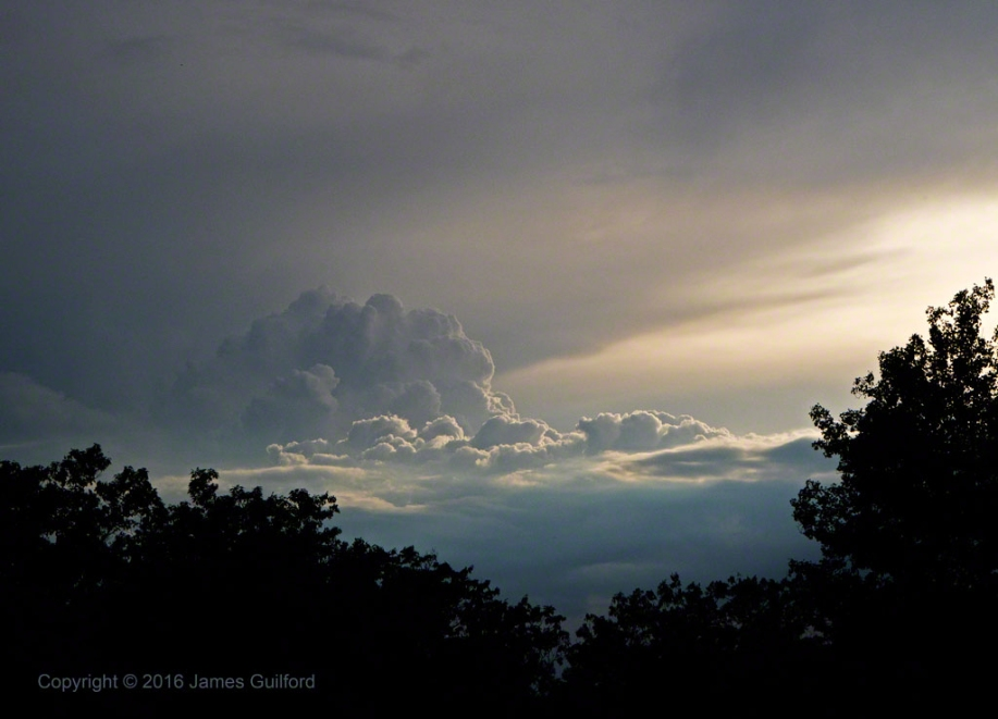 Sunset Towers - A storm builds in the light of the late-day sun. Photo by James Guilford.