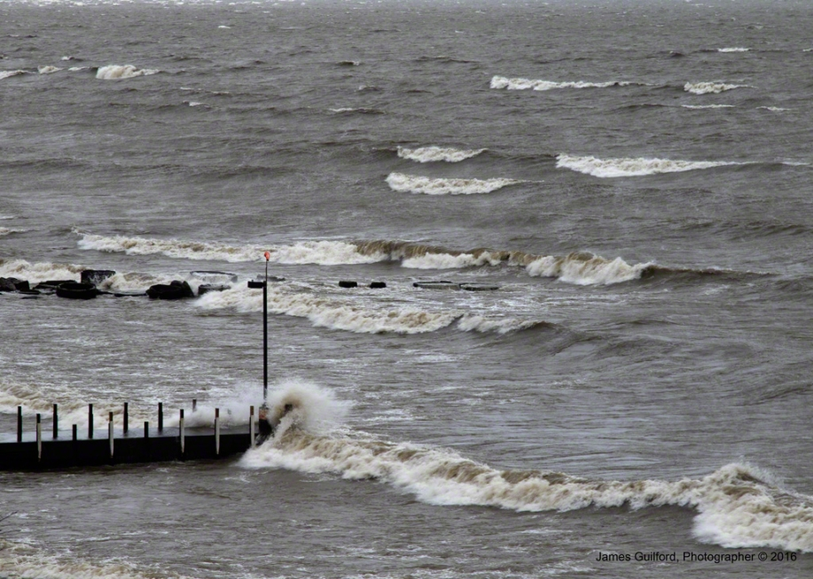 Photo: Breakwall is Pummeled by Wind-Driven Waves. Photo by James Guilford.