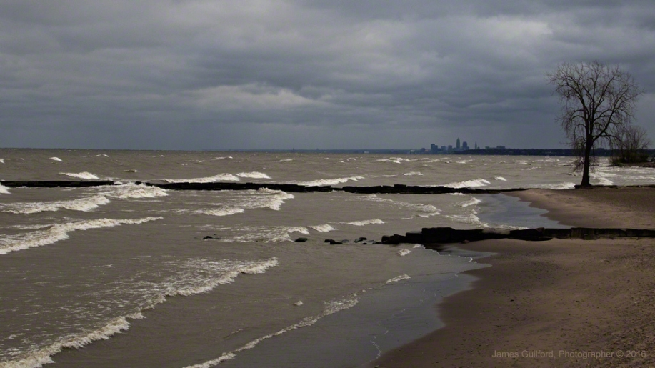 Photo: Wind-driven waves on the Lake Erie Shoreline, city of Cleveland in the background. Photo by James Guilford.