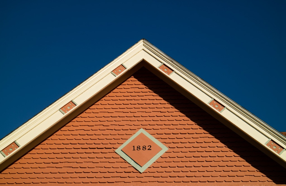 Photo: Gable of a house in Medina, Ohio against an intensely blue sky. Photo by James Guilford.