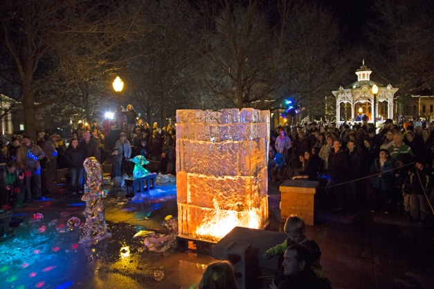 Photo: On Medina's Public Square, crowd lingers around the Fire and Ice Tower. Photo by James Guilford.