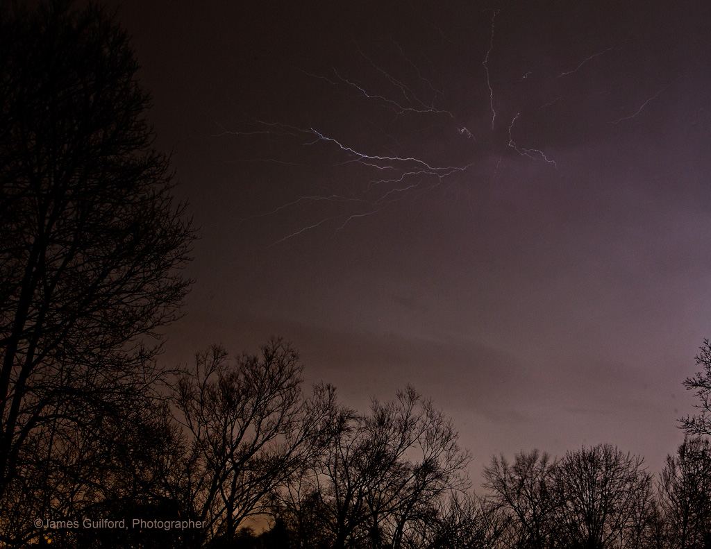 """Lightning arcs in March Thunderstorm Bursting forth and spreading along the underside of the cloud - a """"crawler."""" Photo by James Guilford."""