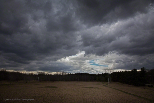 Photo: Storm clouds engulf the last open sky. Photo by James Guilford.
