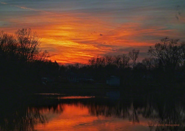 Photo: Colors deepen as night falls; ducks make ripples on the pond. Photo by James Guilford.