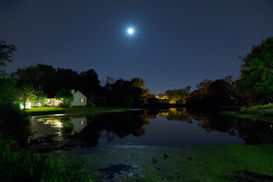 Photo: Moonlit sky and reflections in pond. Photo by James Guilford.