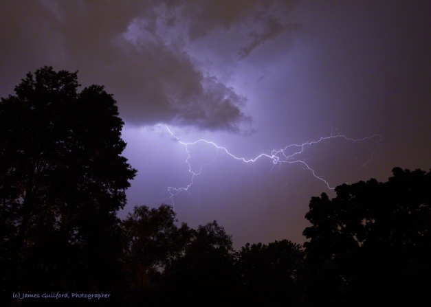 Photo: Bolts in the Blue. A nearby thunderstorm fills the sky with lightning. Photo by James Guilford.