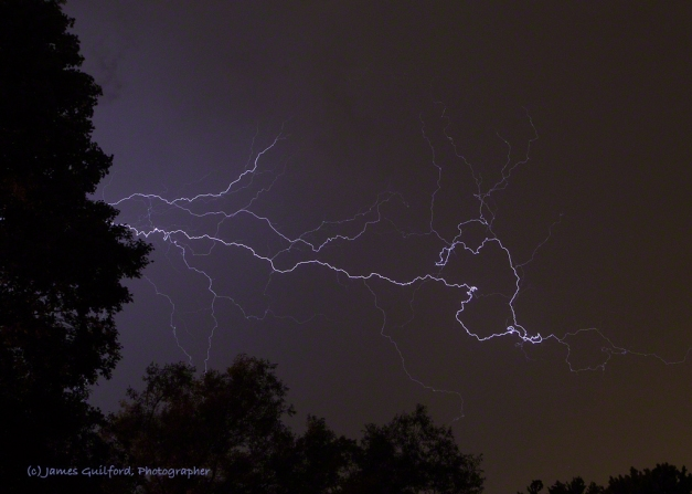 Photo: A Sky Full of Electricity. A nearby thunderstorm fills the sky with lightning. Photo by James Guilford.
