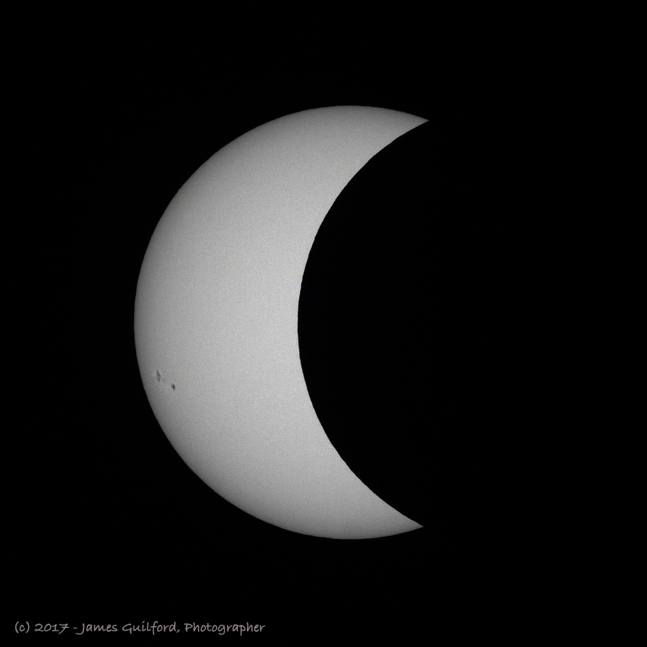 Photo: Solar eclipse in progress, moving towards maximum coverage. Photo by James Guilford.