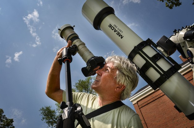 Photo: Photographer with camera and telescope. Credit: Dave Dreimiller.