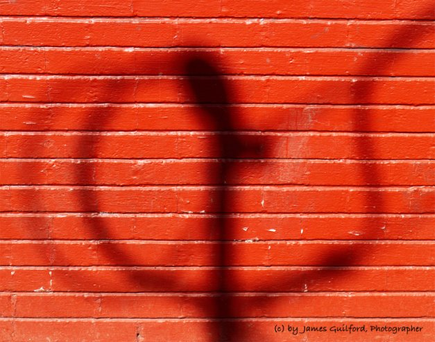 Photo: Orange Shadow: Seen on a wall in downtown Medina, Ohio. Photo by James Guilford.
