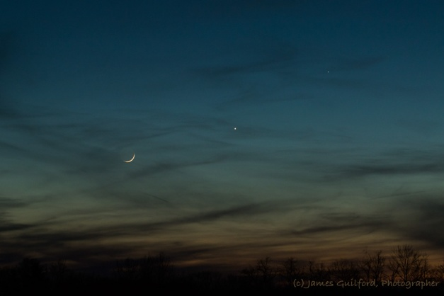 Photo: Blue Conjunction. The setting Moon and planets float in skies that changed in color before finally fading to night. Photo by James Guilford.
