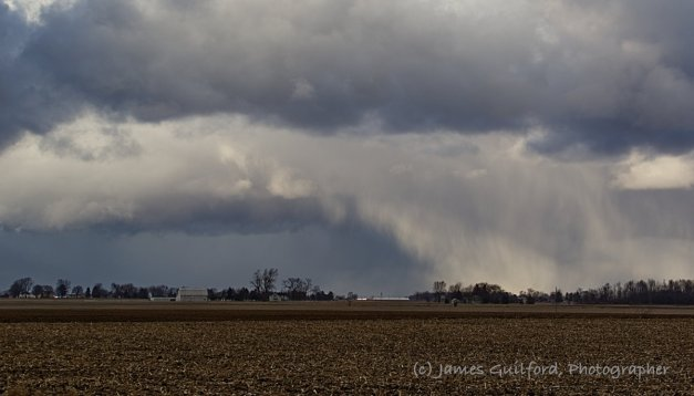 Photo: Snow and graupel falling from their bases make the clouds appear to be collapsing. Photo by James Guilford