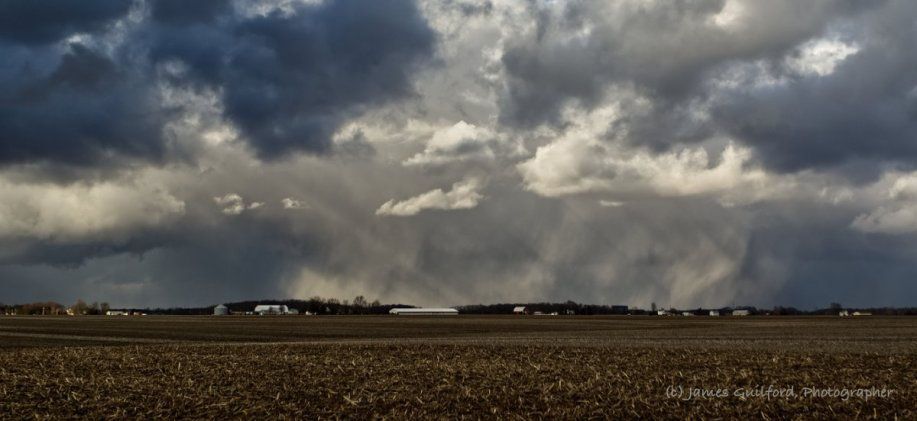Photo: Snow streamers and crepuscular rays interact. Photo by James Guilford.