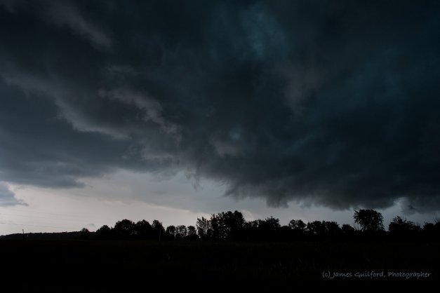 Photo: Threatening clouds cover a bright sky. Photo by James Guilford.