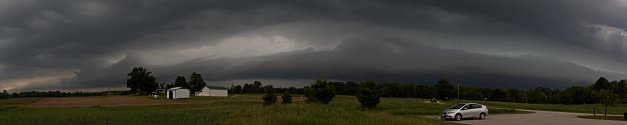 Photo: Approaching roll cloud/shelf spanned many miles across the western horizon as it ushered in heavy rain and some thunder. Photo by James Guilford.