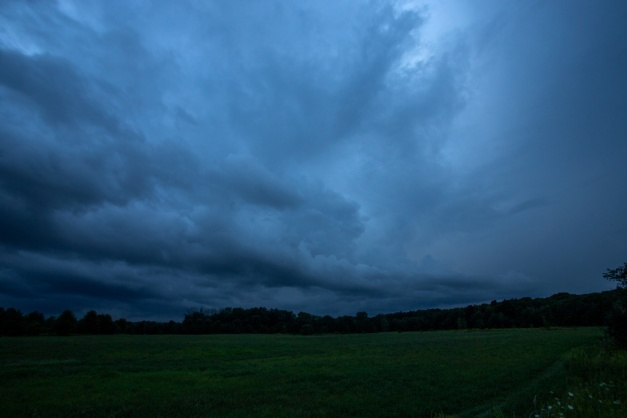 Photo: Darkness Falls. Clouds cover the sky and the blue of nightfall tints the scene. Photo by James Guilford.