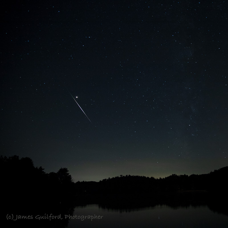 Photo: Sword of Mars: A bright Perseid meteor streaks to the left of planet Mars. Photo by James Guilford.