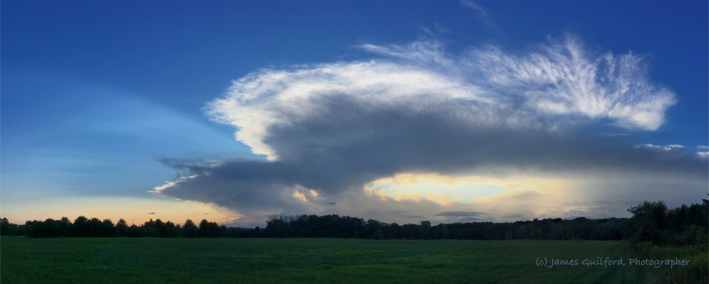 Photo: Thunderbird. Clouds of the approaching storm spread across the western sky. Photo by James Guilford.