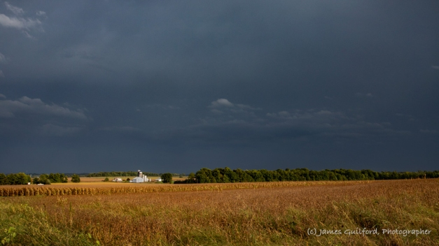 Photo: A severe thunderstorm passes to the south of a farm in rural Wayne County, Ohio as bright sunshine illuminates barn and field. Photo by James Guilford.