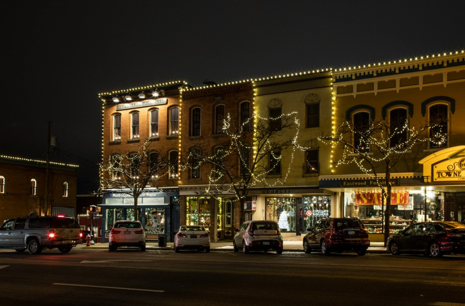 Photo: Buildings along North Court Street, Medina, Ohio, are outlined in lights with windows dressed for the holiday season. Photo by James Guilford.