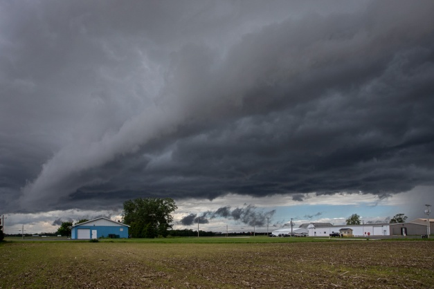 Photo: A gust front rushes closer ushering in a cold air mass and heavy rain. Photo by James Guilford.