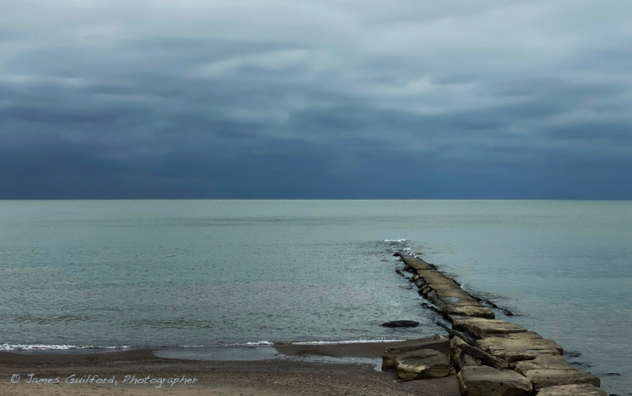 Photo: Dark horizon, glowing Lake Erie Waters. Photo by James Guilford.