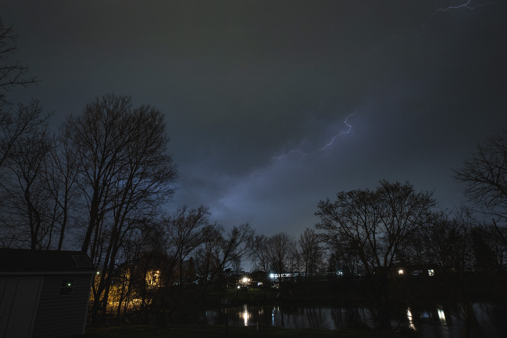 Photo: lightning streaks in night sky.